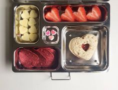 Addi's lunch // peanut butter and strawberry jelly heart sandwich, beet chips, mini apple hearts, strawberry hearts and mini candy hearts.  #valentine #valentinesday #bento #planetbox #valentineslunch #fun #healthy