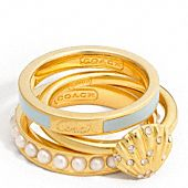 Gold, turquoise, and pearl stacking rings  from coach's new summer on madison ave.
