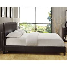 Upholstered in textured Chocolate synthetic leather and decorated with simple baseball stitch seam work, the Square Platform Bed is sure to update your bedroom decor. The headboard highlights a stunning architectural square stitching pattern.