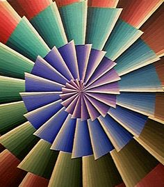 Color-dependent anomalous motion illusion and its reversal