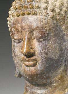 A RARE GRAY LIMESTONE HEAD OF BUDDHA<br>China, Tang dynasty | Lot | Sotheby's