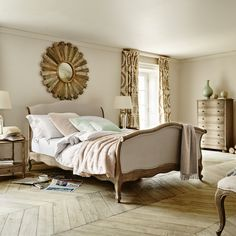 Introducing Annecy; a softly curved sleigh bed in weathered oak with a luxury upholstered finish. A perfect addition to any French style boudoir