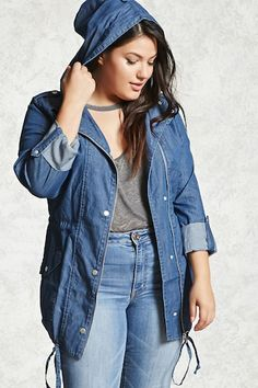 A lightweight utility jacket crafted from a chambray woven fabric, featuring a snap-buttoned zip front, snap-buttoned long sleeves,  a drawstring waist, snap-buttoned front patch pockets, and a hood.