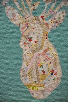 String-pieced appliqued stag by Rana Heredia of Sewn Into the Fabric.  Stag Nation pattern. 2015 Spring Quilt Market. Photo by Moda Fabric blog.