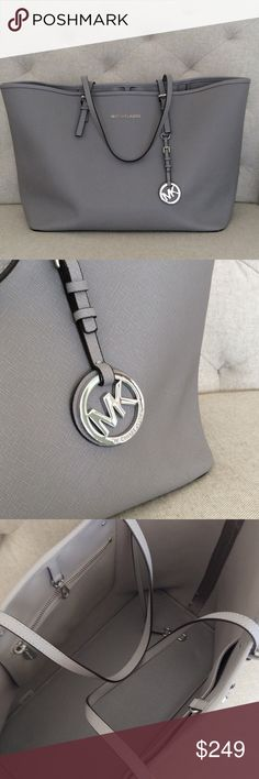 """Michael Kors Jet Set Saffiano Tote Saffiano leather tote in grey. Dust bag included. 14"""" wide at base, 19"""" wide across top, 11"""" tall, 7"""" deep, 8"""" strap drop. No trades, please. Michael Kors Bags Totes"""