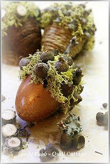 Plastic egg acorns ~ how creative! Maybe glue jute twine around top to make top of acorn instead of moss.