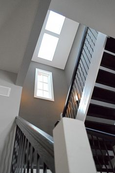 Love the grey walls and white and black stair case