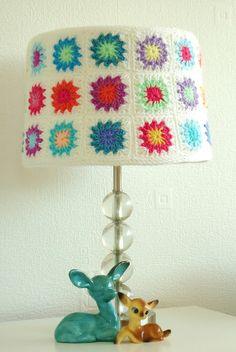 #Crochet a lampshade cover like this one. It will definitely add some color to the room.