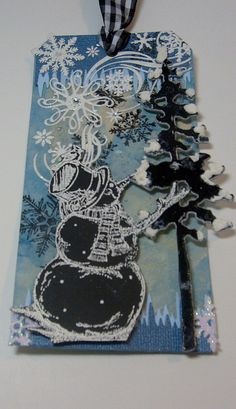 Blues, black and white, snow. Snowman with tree. Christmas. Fancy snowflakes.