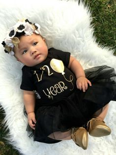 Pictures do not do this adorable, one of a kind girls 1/2 Birthday shirt justice! Every little princess turning6 months oldneeds this adorable tee to ring in herhalf Bdaycelebrations! It is so hard to capture the boldness & sparkleof the gold in a photograph, but one thing is for sure- you will not be disappointed! Fancied on a black baby bodysuit or toddler / kid t shirt in a gold metallic design!#LivAndCo