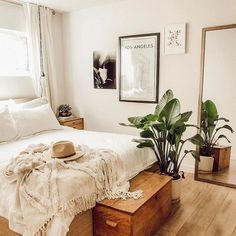Beautiful neutral bedroom with greenery