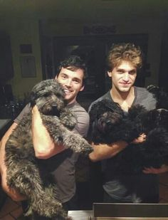 Ian and Keegan with dogs. Can it get any cuter?