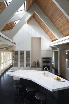 Kuth/Ranieri Barn Road kitchen | Remodelista boomerang shaped kitchen island