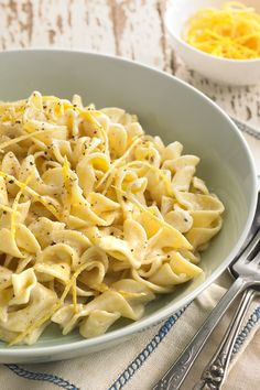 NYT Cooking: This astonishingly delicious pasta dish is surprisingly easy to make. Just combine the zest of two lemons, heavy cream, salt and pepper in a saucepan, and let it come to a boil. Pour over freshly-cooked egg noodles, add fresh lemon juice and toss. Cook for a couple minutes until the sauce has thickened slightly and cloaks the noodles in a rich, creamy, lemon-y brightness. It's luxurious weeknight cooking at its best.