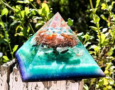 A Violet Flame Orgone pyramid intended to purify your EMF, and support the flow of energy between your Third Eye and Heart Chakra. Working with the energies of the Harvest Full Moon, I used specific healing crystals in this orgone pyramid, to maximize the manifestation potential of this potent planetary line up. A powerful meditation and Feng Shui balancing tool, place this orgone crystal pyramid on your altar or in a sacred space to clear your energy body and create space to live a life in…