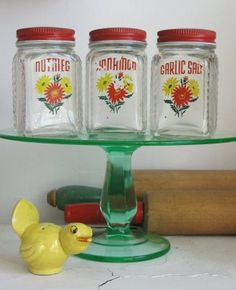 Vintage spice jars on a Depression Glass Cake Stand - and possibly a little Pie Bird...