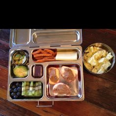 Kid's Lunch - Zucchini, sweet potato fries, cheese, apples and almond butter, kiwi, blueberries, avocado, dark chocolate, and egg salad.