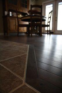 Hardwood border around tile