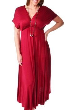 This lovely, airy plus size maxi dress by 24/7 Comfort Apparel features a faux wrapped effect at the bodice, creating a deep feminine V-neckline to flatter any figure. Slight stretch in construction and an empire waist give this pull-on dress a flattering, comfortable fit. The solid color and folded design allows the maxi to be dressed up or down for a variety of day-to-night looks.   Plus-Size Faux-Wrapped Maxi by 24/7 Comfort Apparel. Clothing - Dresses - Casual Clothing - Dresses - Maxi…