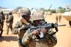 Members of the Ugandan Special Forces, as part of the African Union Mission in Somalia, takes part in an operation to clear a suspected building on October 6, 2014, in the town of Barawe, Somalia.