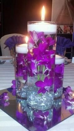 Purple Wedding Flowers Submerged purple dendrobium orchids with underwater led lighting! Purple Wedding Centerpieces, Lighted Centerpieces, Submerged Flower Centerpieces, Fishbowl Centerpiece, Graduation Centerpiece, Centerpiece Ideas, Wedding Themes, Wedding Decorations, Wedding Ideas
