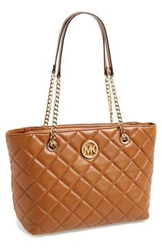 This Michael Kors classic style quilted tote is perfect for work.