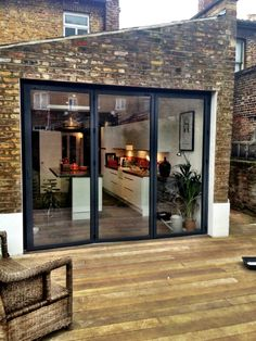 Large bi-fold doors leading from the kitchen onto the deck. Would bring in a lot of light.