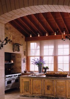 Traditional Kitchen - Farmhouse - Kitchen - new york - by Peter Vitale Photography Like the stone work, inset stove, large wall of windows Cozy Kitchen, Farmhouse Style Kitchen, Wooden Kitchen, Kitchen Ideas, Smart Kitchen, Vintage Kitchen, Distressed Kitchen, Rustic Kitchens, Kitchen Industrial