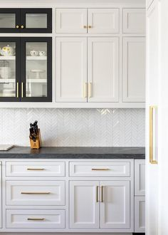 White Shaker Kitchen Cabinets With Various Black Frame Cabinet