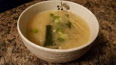 Miso soup    1 tablespoon of white soybean paste  Enoki mushroom  Chopped scallion  Dice seedweed