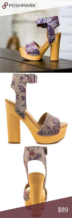 Wooden Flower Print Platform Sandal This Platform sandal features a grey suede upper with beautiful floral print. Created from real wood is a 5 1/2 inch block heel and 1 1/2 inch platform. Shoe Details: Leather Upper Man Made Sole This Shoe Fits True To Size. Nasty Gal Shoes Platforms
