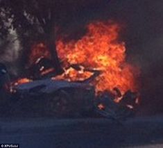 Fiery crash: Paul died when the red Carrera GT Porsche driven by friend Roger Rodas careered off the road. He had just left a fundraiser for his charity Reach Out Worldwide
