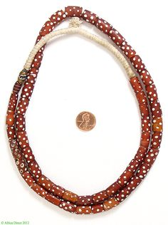 Trade Beads | Wound and decorated Red Skunks Flat Ended Cylinder Shape Venetian Trade Beads | Made for the African Trade | 20th century | strand 410.00$