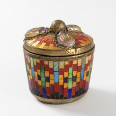 """A Tiffany Studios New York """"Scarab"""" mosaic and gilt bronze covered box by Louis Comfort Tiffany. This round box is decorated with vivid mosaics of red, yellow, orange, green, turquoise blue and black. The cover has three applied favrile glass scarab beetles. The scarabs confirm Tiffany's fascination for Egyptian archeological discoveries and are a fine expression of his inspiration. Circa 1905.  Available at www.macklowegallery.com Tiffany Art, Louis Comfort Tiffany, Archaeological Discoveries, Antique Collectors, Aesthetic Movement, Wood Bridge, Covered Boxes, Leather Working, Leather Men"""
