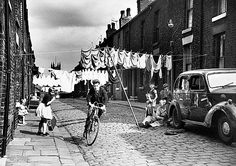 Cycling along a terraced street, Salford, Manchester Shirley Baker (Mary Evans Picture Library) Old Pictures, Old Photos, Shirley Baker, Black N White Images, Black And White, Manchester Street, Manchester England, Shoes Too Big, Street Portrait