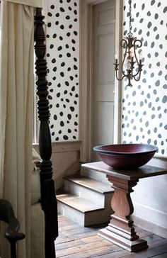 interesting geometry & juxtaposition of wallpaper & wood table and bowl