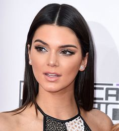 Brown eyes are sometimes considered blah, but Kendall amped up her eye makeup using a bevy of silver metallic shadows. Meanwhile, her hair was styled superstraight for the AMAs red carpet.  Source: Getty / Steve Granitz