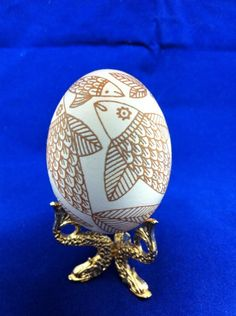 Etched brown chicken egg with fish motif done by Theresa Somerset of http://www.precisionartstudio.com