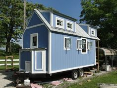 Tiny house built on 23-ft trailer; tankless water heater, RV hookups, washer/dryer, etc... sold on Craig's List in Kansas City for $22,500.... I want one like this!