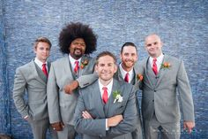 Grey Suits  with Red Ties, love the contrast.  Luxury Wedding Photography by photographer Paul Barnett.