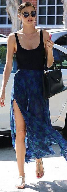 Miranda Kerr: Sunglasses – Miu Miu  Necklace – Opa Designs  Skirt – Topshop  Shoes – Valentino