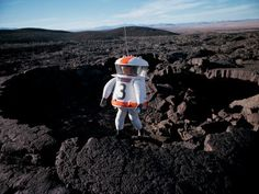 Technician Testing Space Suit for Apollo Moon Mission in Mojave Desert Lava Cave