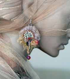 These lightweight romantic earrings are hand sewn from tattered vintage laces and silks, mohair threads. Adorned with vintage clear Swarovski crystals, red (ab) Swarovski crystals and seed beads, fine mohair..  Though looking ethereal, the earrings are made sturdy to hold their shape and lined with fine silk at back for more comfort and clean look. Please notice the earrings vary slightly from each other due of their completely handsewn nature.  Beautiful unique gift idea, all textile…