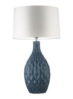 "Shown here in the beautiful and intense Prussian Blue colour option, the Otranto table lamp features carved ridges emphasising the generous ceramic form. Details Base Code: C/OTRA/BL/T Lampshade: 16"" Roman Drum Glaze Ivory Shade Lining: White PVC Shade Code: 16RMD/GI Cable: Navy Twisted Dimensions Full height with shade: 735 mm Base Height: 475 mm Base …"