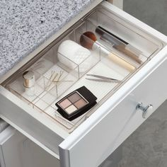 Use a bathroom drawer organizer tray to keep items in your drawers from getting jumbled, and to speed up getting ready in the morning since you won't be searching for stuff in the drawers {featured on Home Storage Solutions 101}