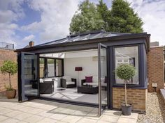 The Quantal aluminium conservatory roof is strong and visually stunning. ✅ Equates More Light ✅ Free Online Aluminium Conservatory Quote. Rooftop Design, Rooftop Terrace, Patio Design, House Design, Garden Room Extensions, House Extensions, Extension Veranda, Modern Conservatory, Pergola