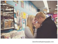 engagement photos, engagement photos in the city, engagement photos in a record store