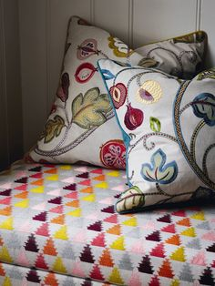 Cushions in Santana and stool in Carnival from the Havana Collection by Jane Churchill
