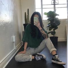 green tee shirt + striped pants + black sneakers