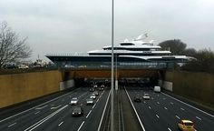 A Giant Yacht Passing Through an Aqueduct Above a Major Highway